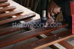 изработка на дървени огради от дървени пана боядисани с боя по RAL каталог
